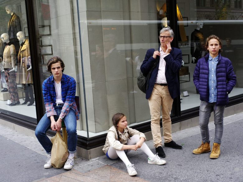 Family in front of H&M. NYC, 2017