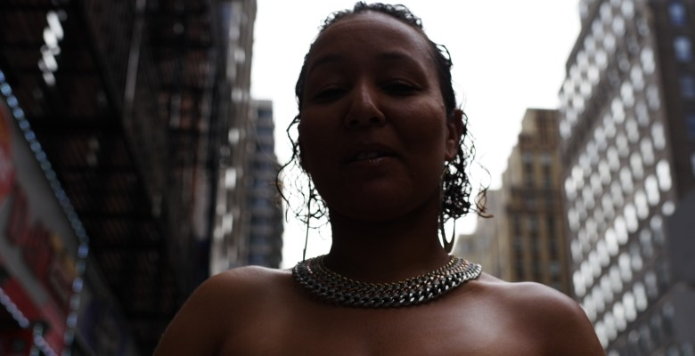 Street portrait. Woman with chain necklace. NYC, 2017