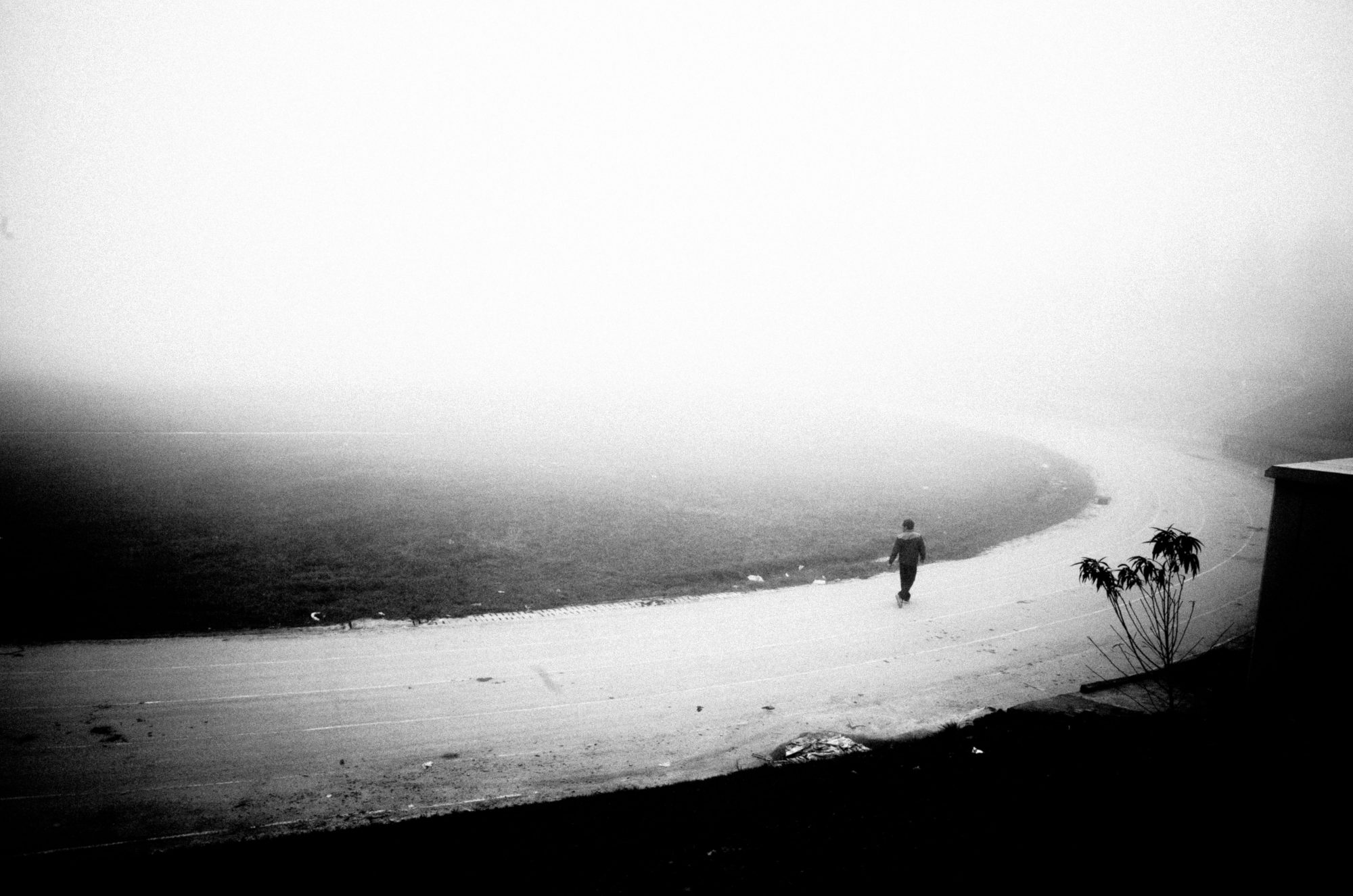Man walking in mist. Sapa, Vietnam 2016