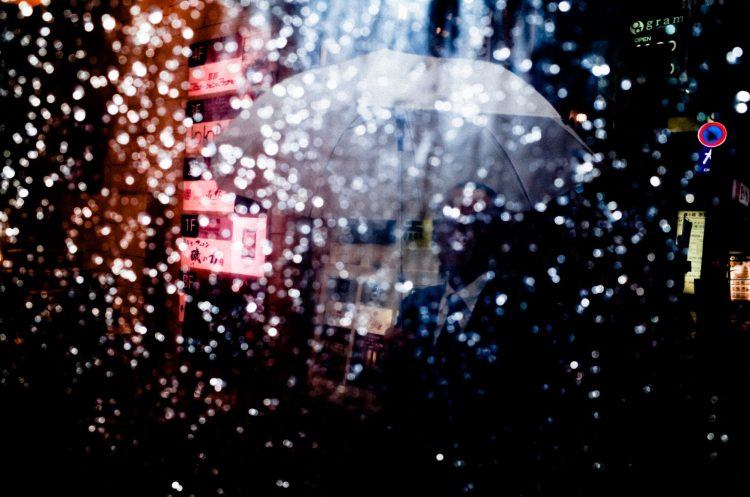 Flash umbrella street photograph with red and blue. Kyoto, 2017