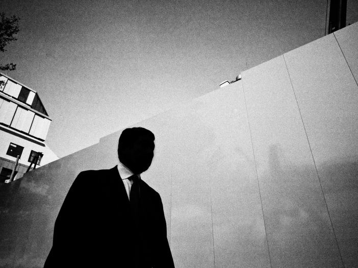 Silhouette suit man. Street photograph in Tokyo, 2011