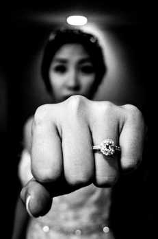 Cindy with wedding ring and fist.