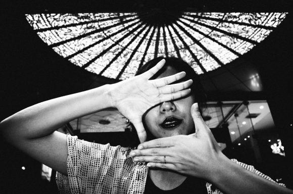 Cindy with framed hands. Saigon, 2017