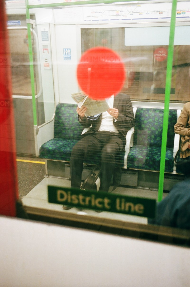 Red dot on the suit in London metro. Cherry on top is the red dot.