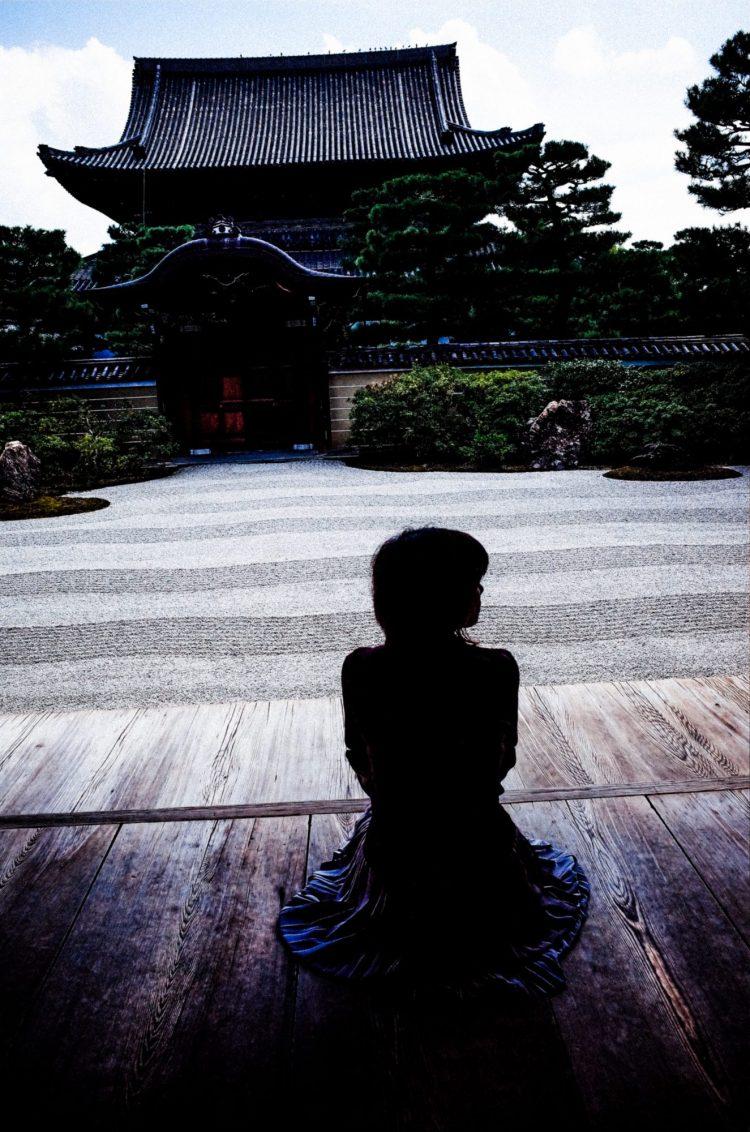 Negative space around woman. Kyoto zen temple, 2017