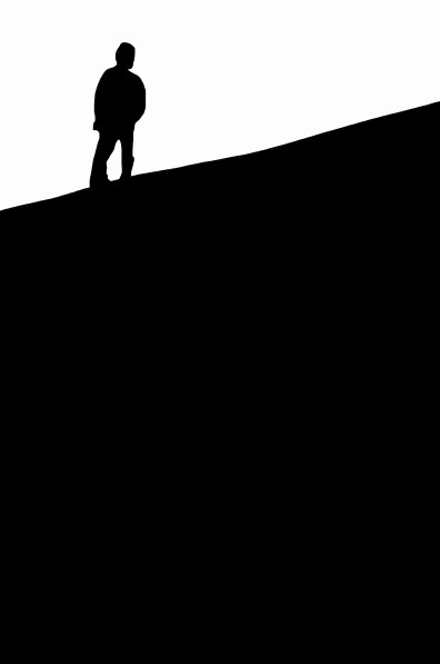 Abstract. Simple figure to ground composition. Man in silhouette in black in top left of frame against white sky.