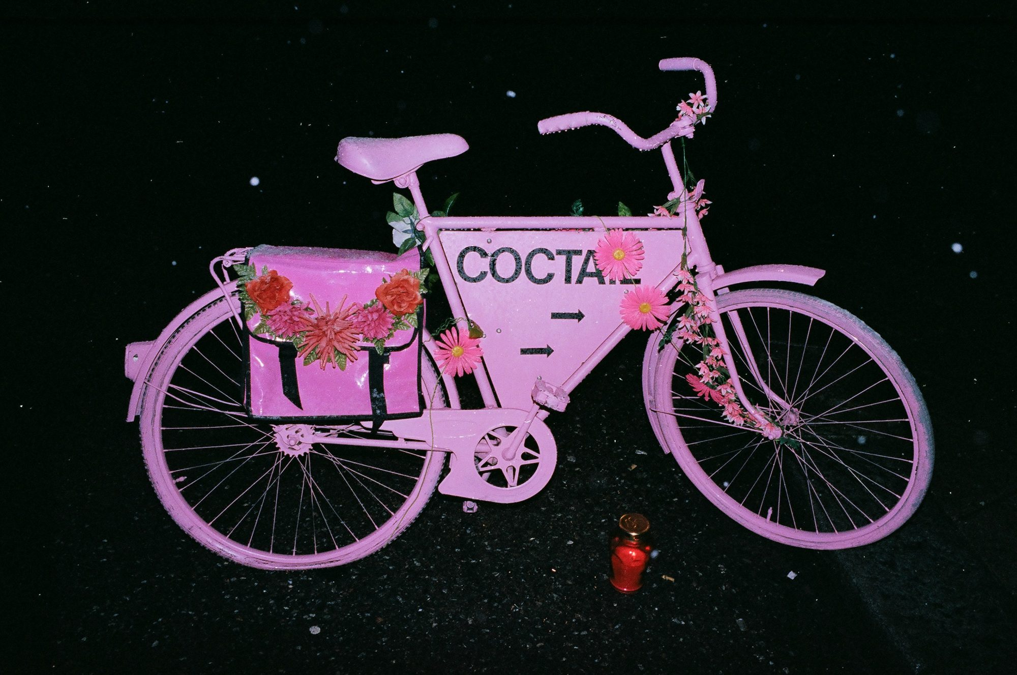 Pink bicycle in Amsterdam with flash.