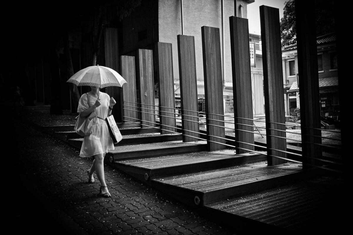 Walking woman with umbrella. Seoul. 2009