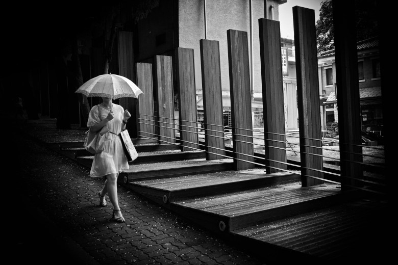 Walking woman with umbrella. Seoul. 2009