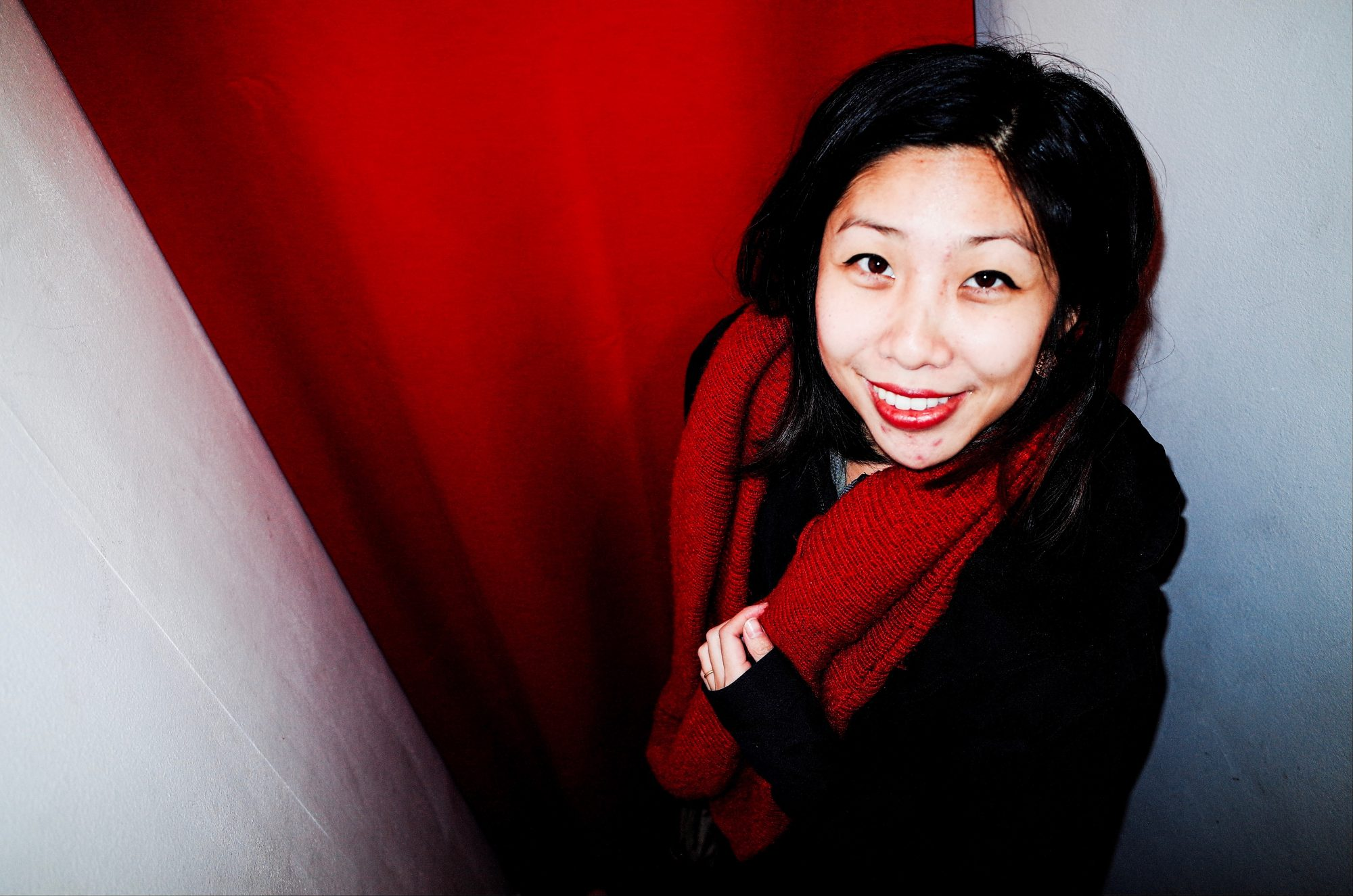 Cindy in red scarf, red background. Marseille, 2017