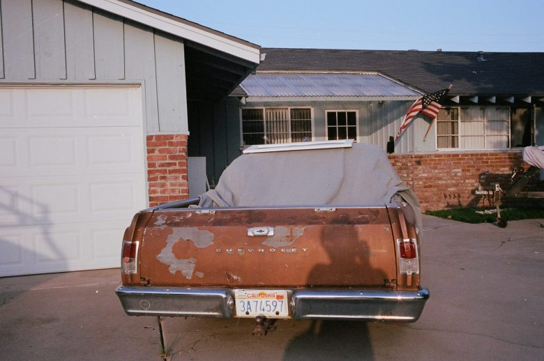 Selfie of my shadow in the suburbs of Orange County, with old car.