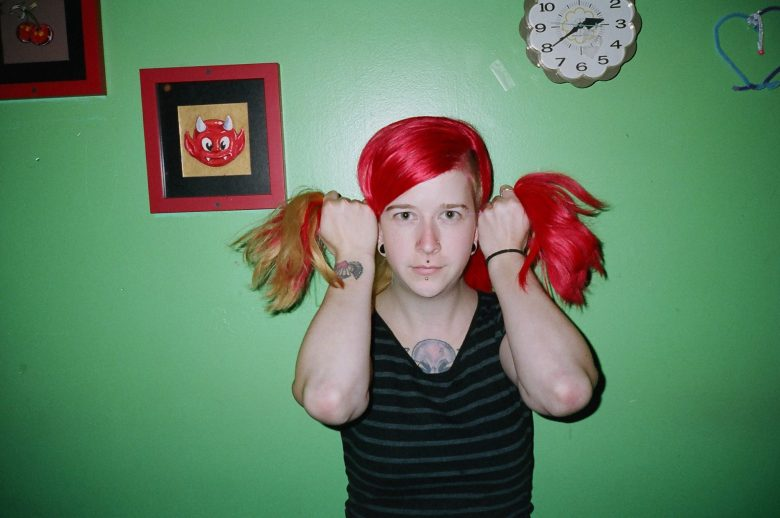 Girl with red pigtails. Philadelphia, 2013