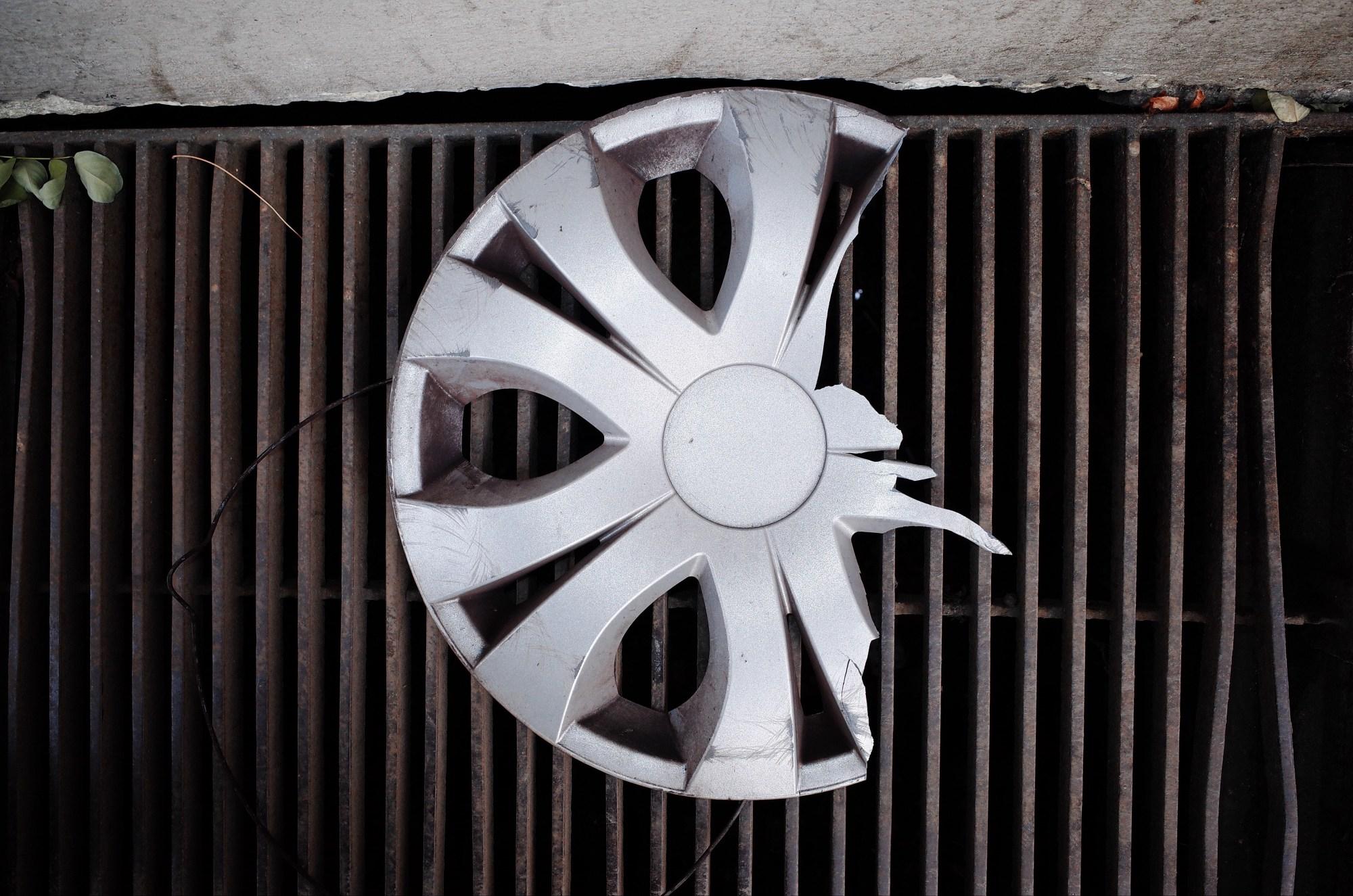 Broken wheel hubcap. Prague, 2017