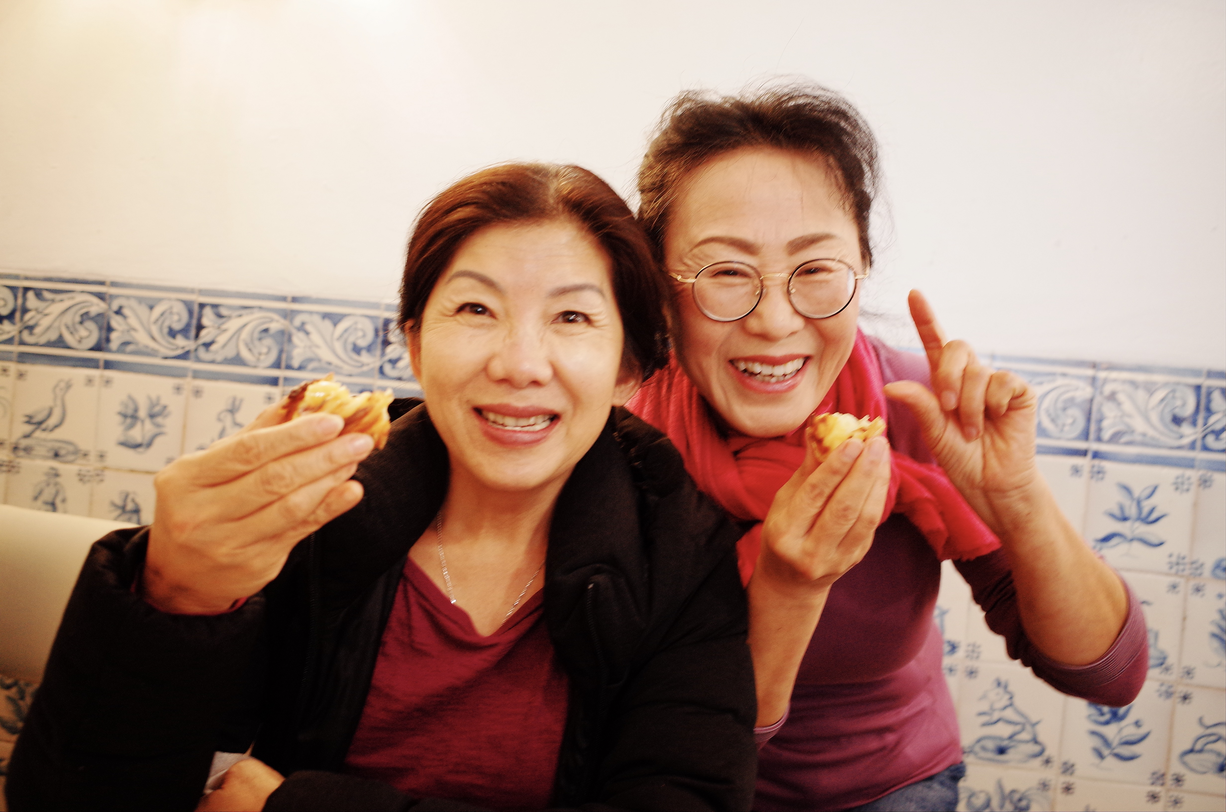 Cindy's mom and my mom, enjoying Portuguese Egg Tarts in Lisbon, a photo that puts a smile on my face :)