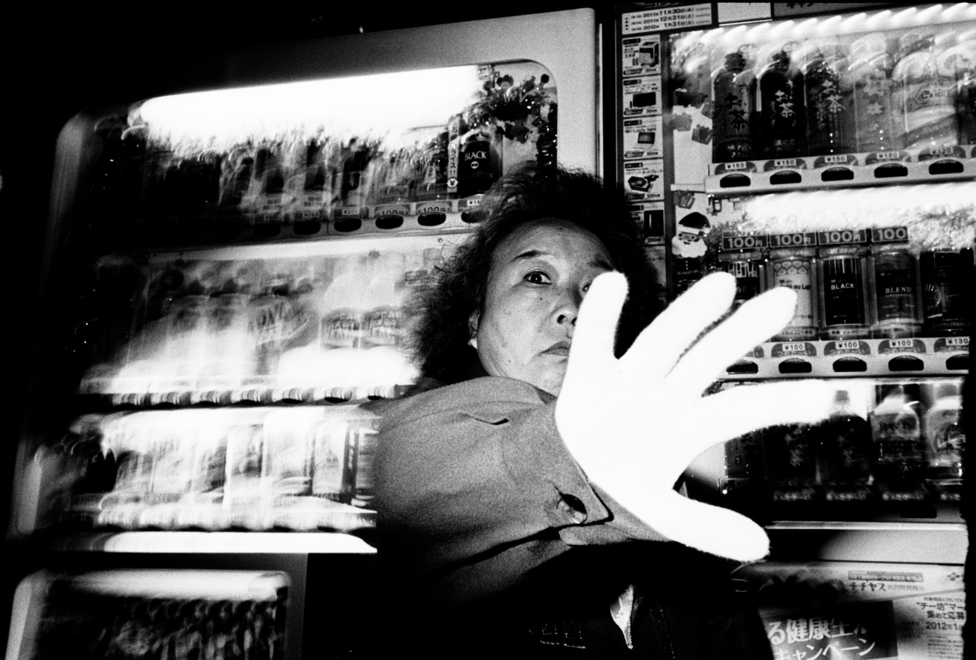 Tokyo woman with hand. 1.2 meters, flash, Kodak Tri-X 400, Leica M6, 35mm