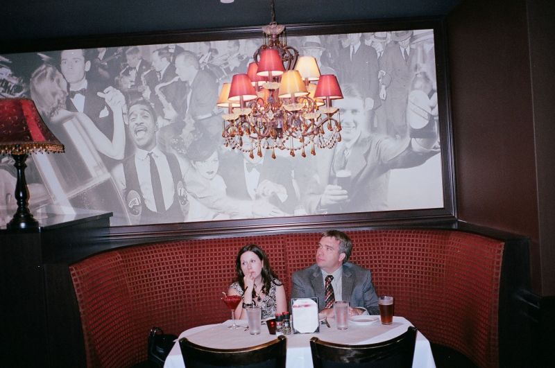 Suit and woman in restaurant. Flash, 35mm Leica MP, Kodak Portra 400. Shot at around 2-3 meters.