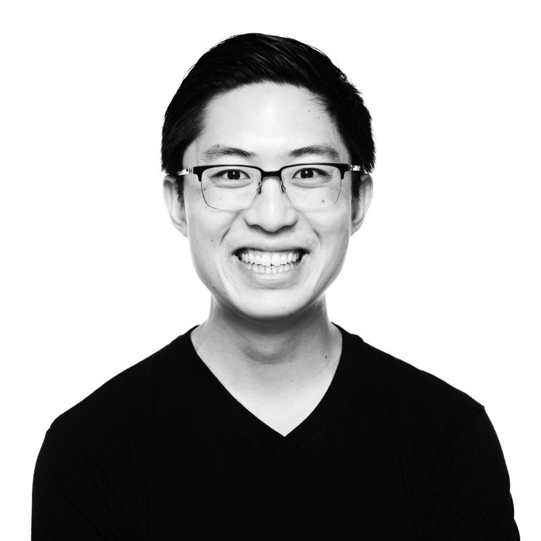 Black and White Headshot of ERIC KIM by John Hall