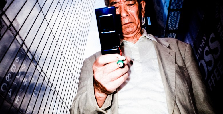 Tokyo man flip phone. Tokyo, 2017. Shot on RICOH GR II with flash, with ERIC KIM Color Preset