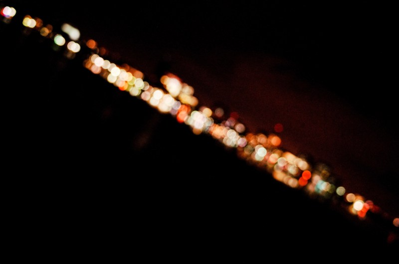 Dutch angle composition. Boston bridge at night, out of focus.