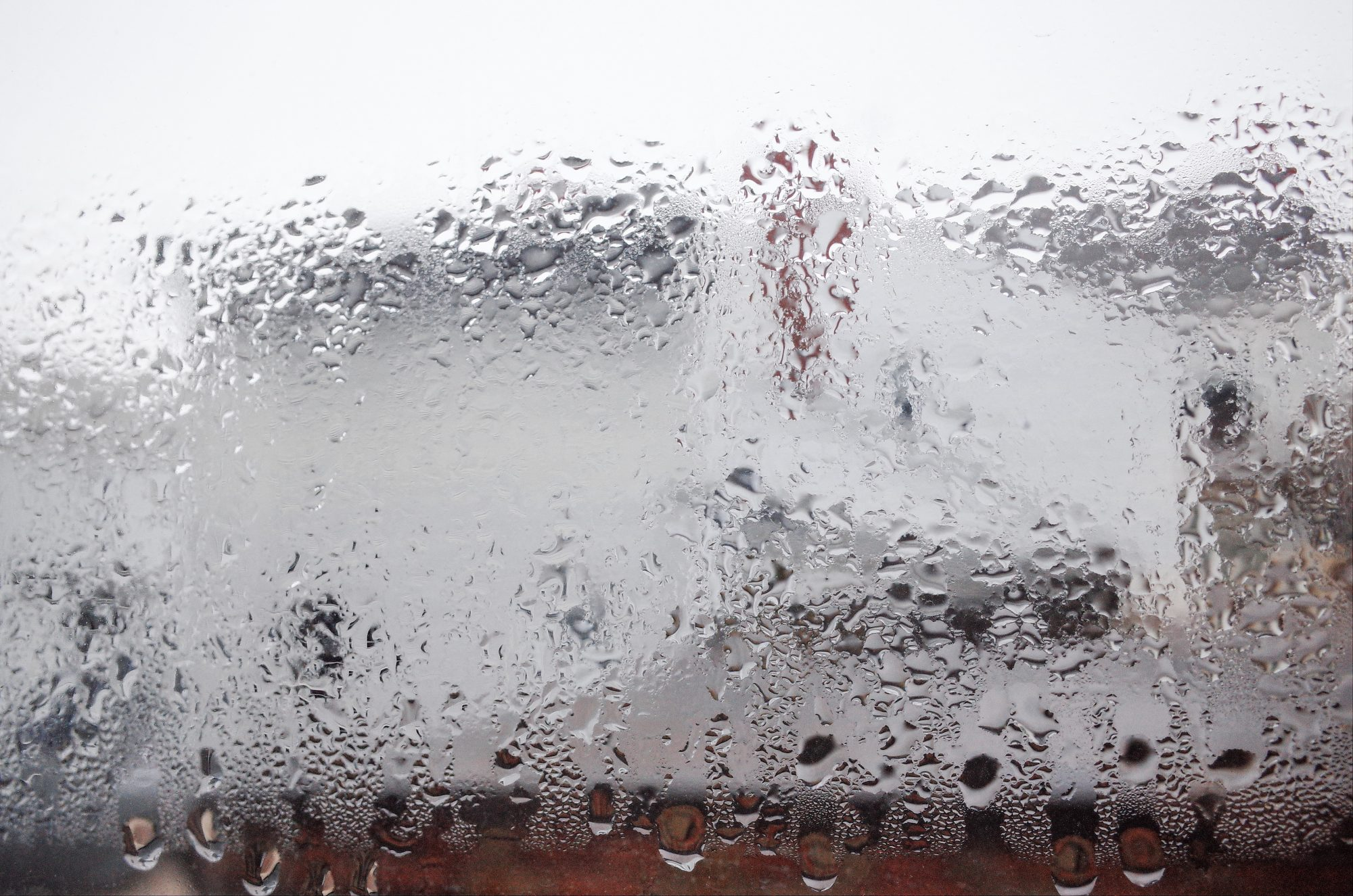 Condensation on window, out of focus. Focus set on the water droplets. Macro mode, RICOH GR II.