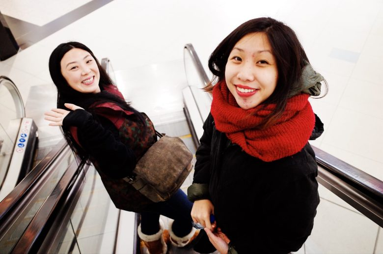 Annette and Cindy on escalator. London, 2018