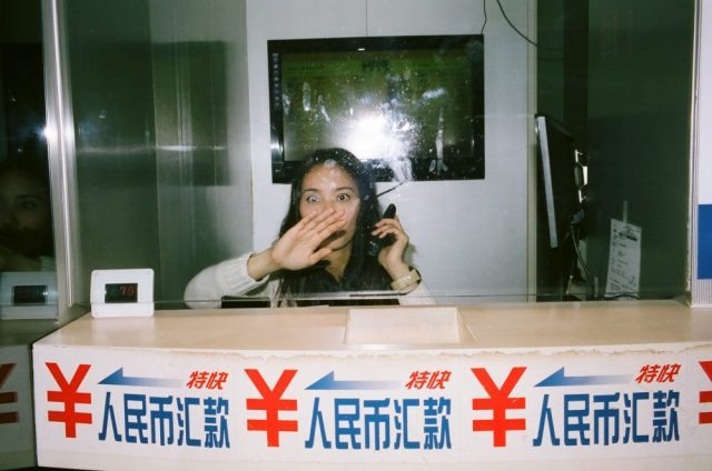 Portra 400 flash without permission. Hong Kong, woman with hand on face. Exchange currency. Street photography eric kim.