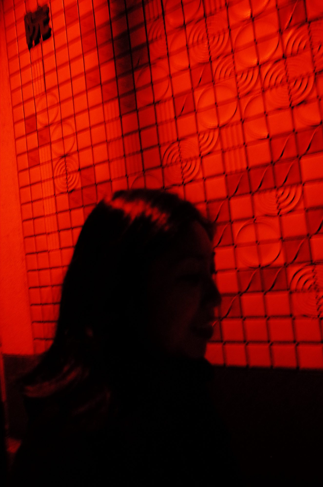 Red wall, Cindy walking. Kyoto Uji, 2018
