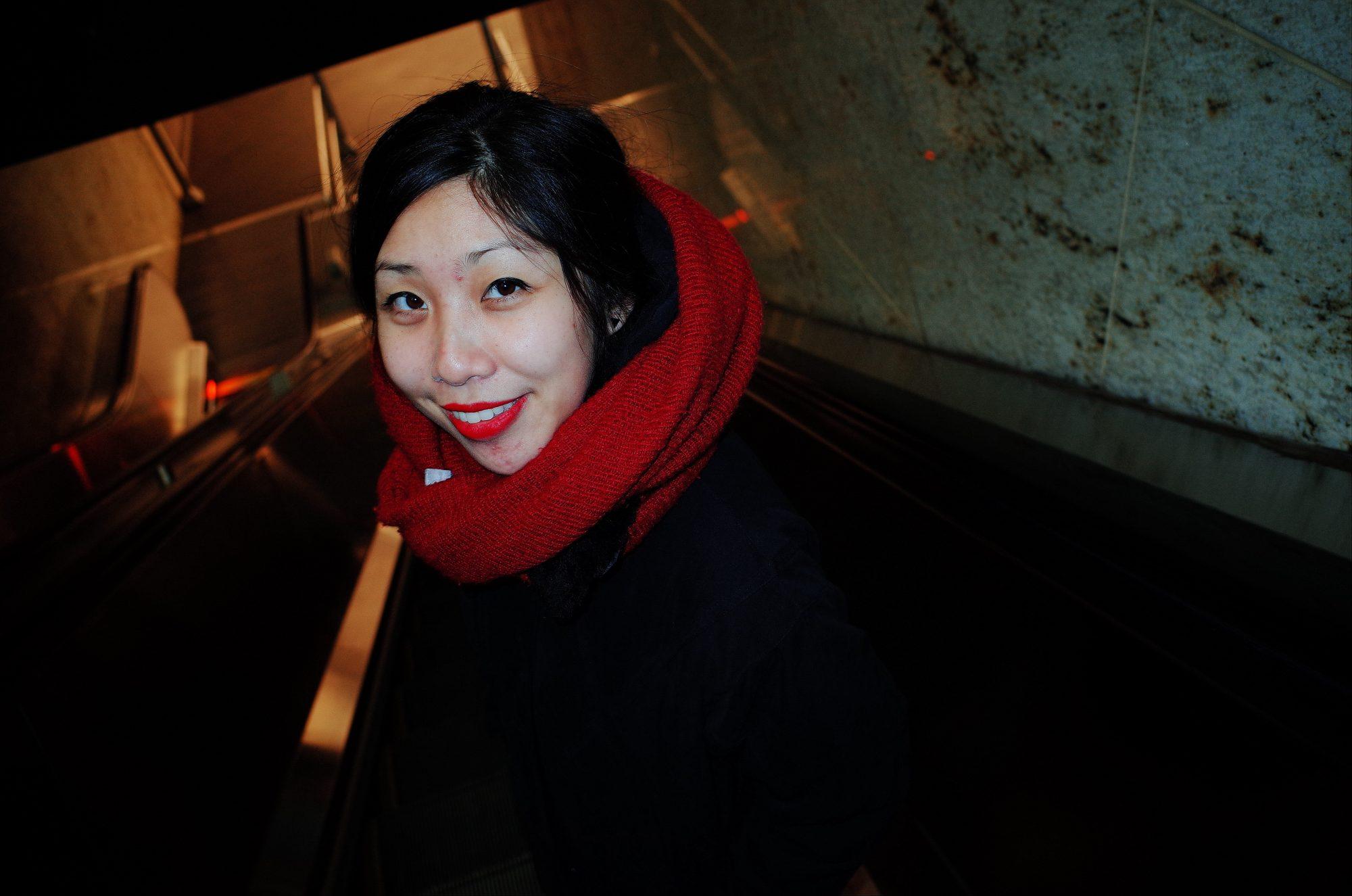 Cindy going down escalator. NYC, 2018