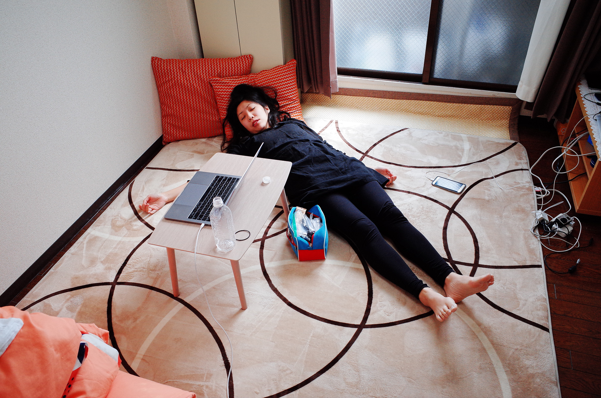 Cindy taking a nap in our Osaka Airbnb, 2018