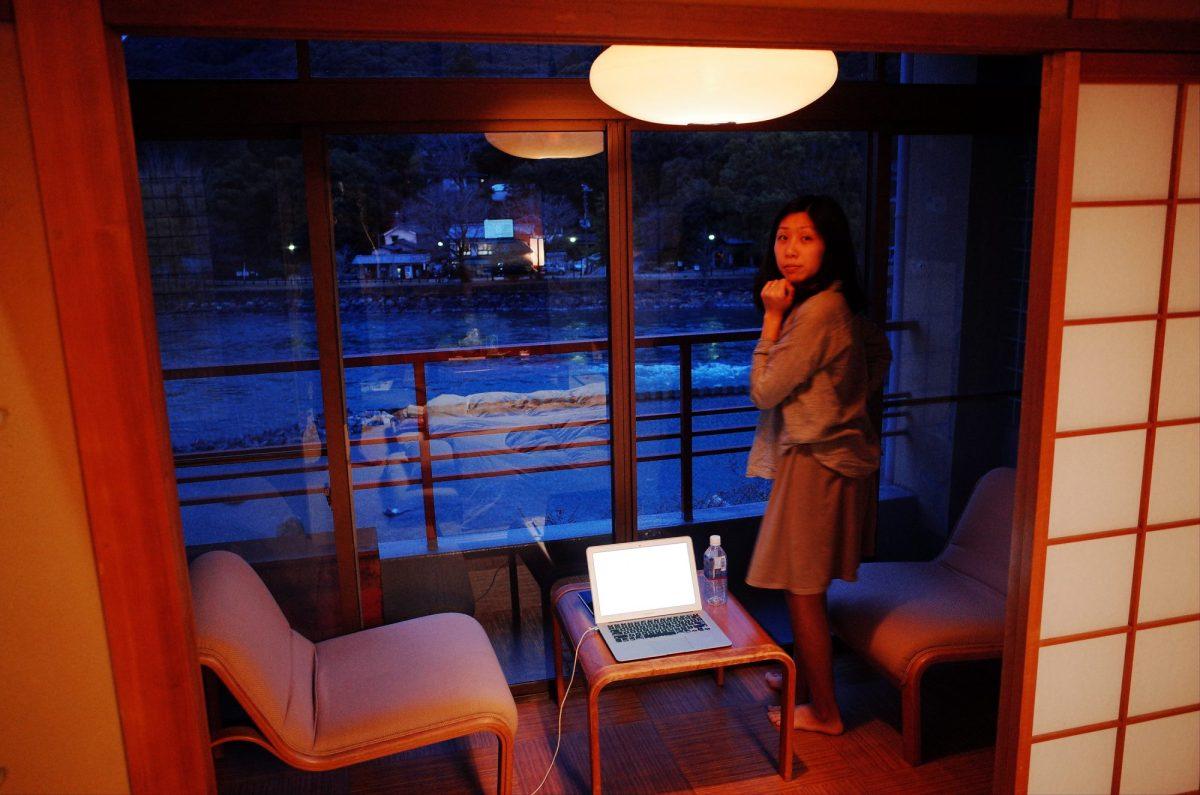 Cindy looking at river. Ryokan. Uji, 2018
