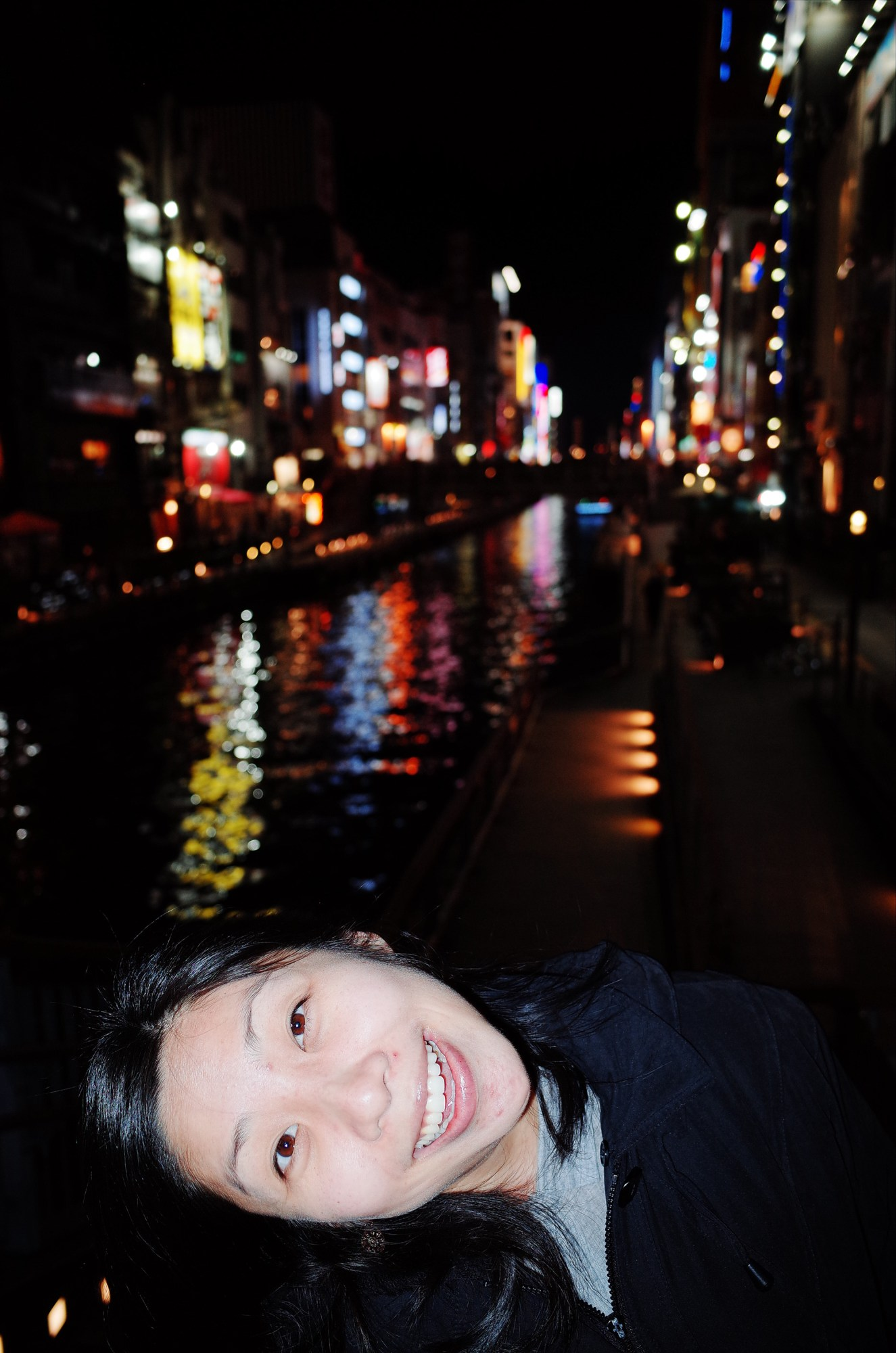 Cindy tilting her head, and Osaka river at night. 2018