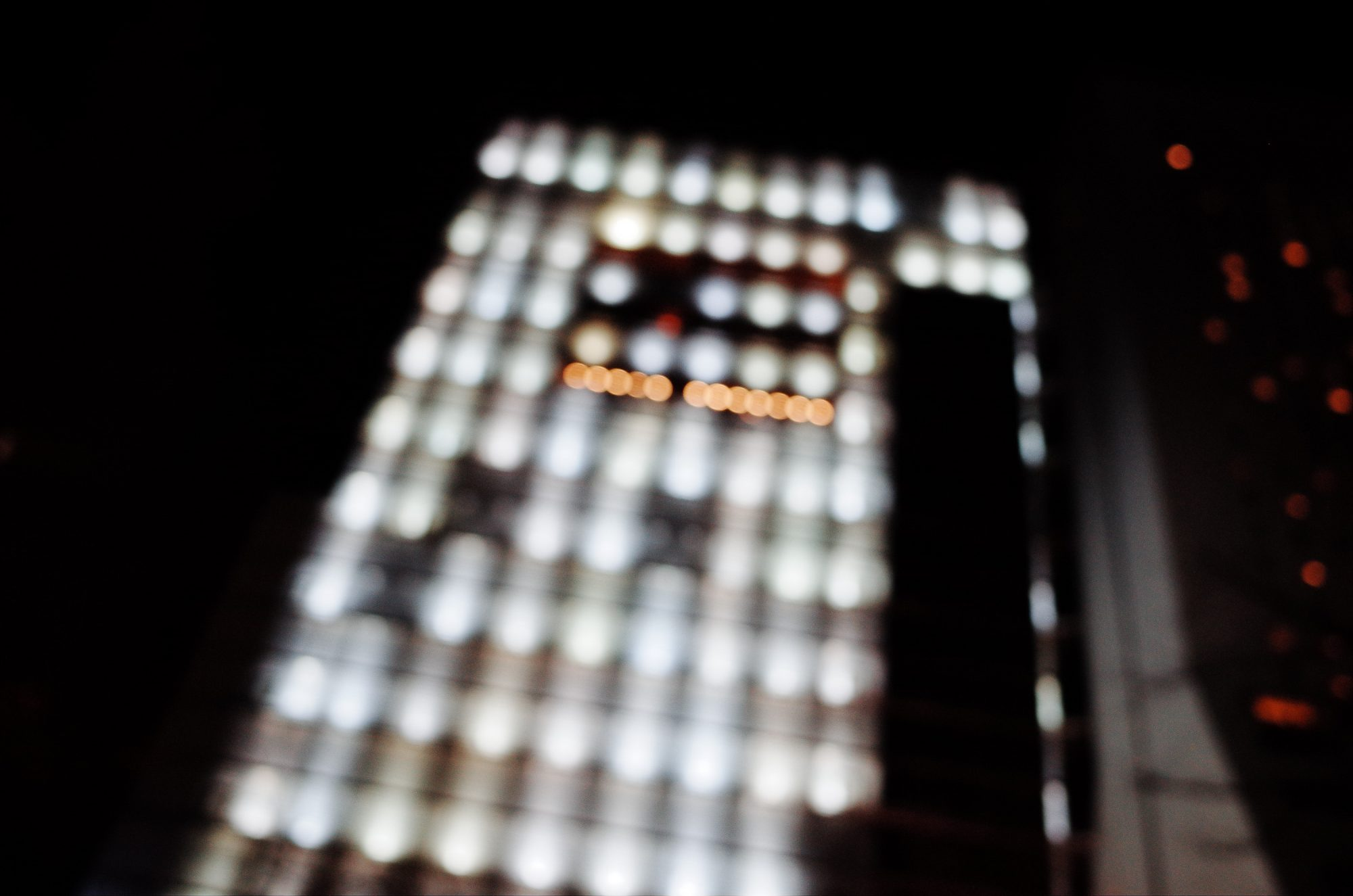 Out of focus bokeh lights in skyscraper building. Osaka, 2018
