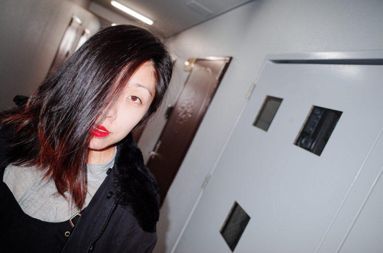 Dutch angle composition tilt. Cindy in hallway. Osaka, 2018