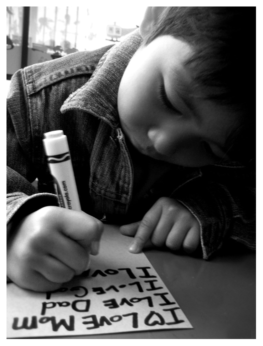 "2007. Canon Powershot, Giju writing: ""I love Mom"""