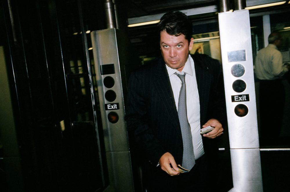 Suit walking through subway