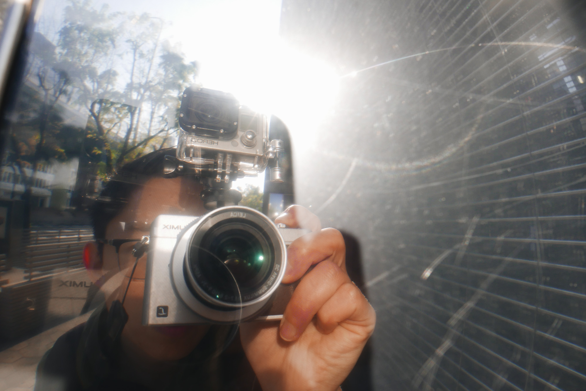 Selfie with Lumix LX100 and GoPro mounted. Osaka, 2018