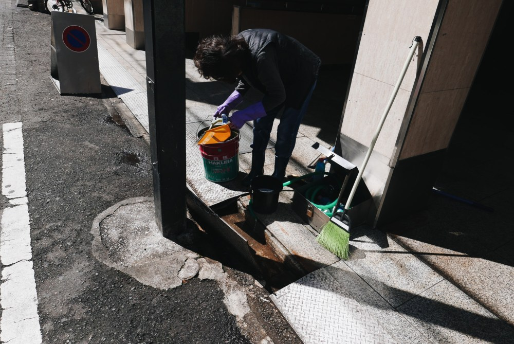 Woman cleaning shadows