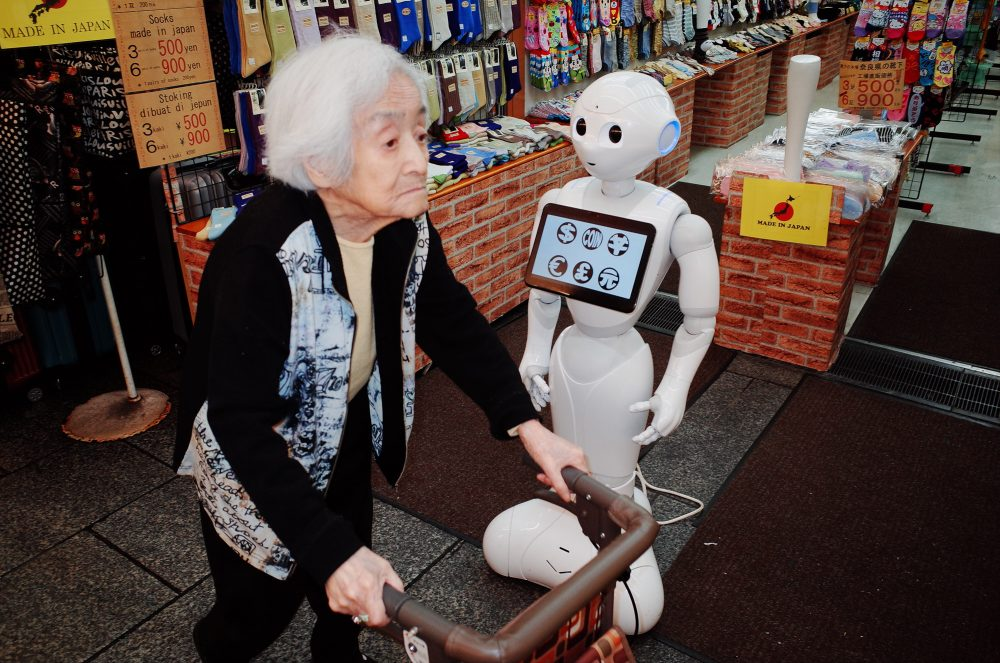 Old Japanese woman and Japanese robot