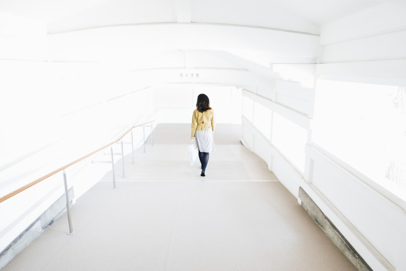Cindy walking down white corridor. Kyoto
