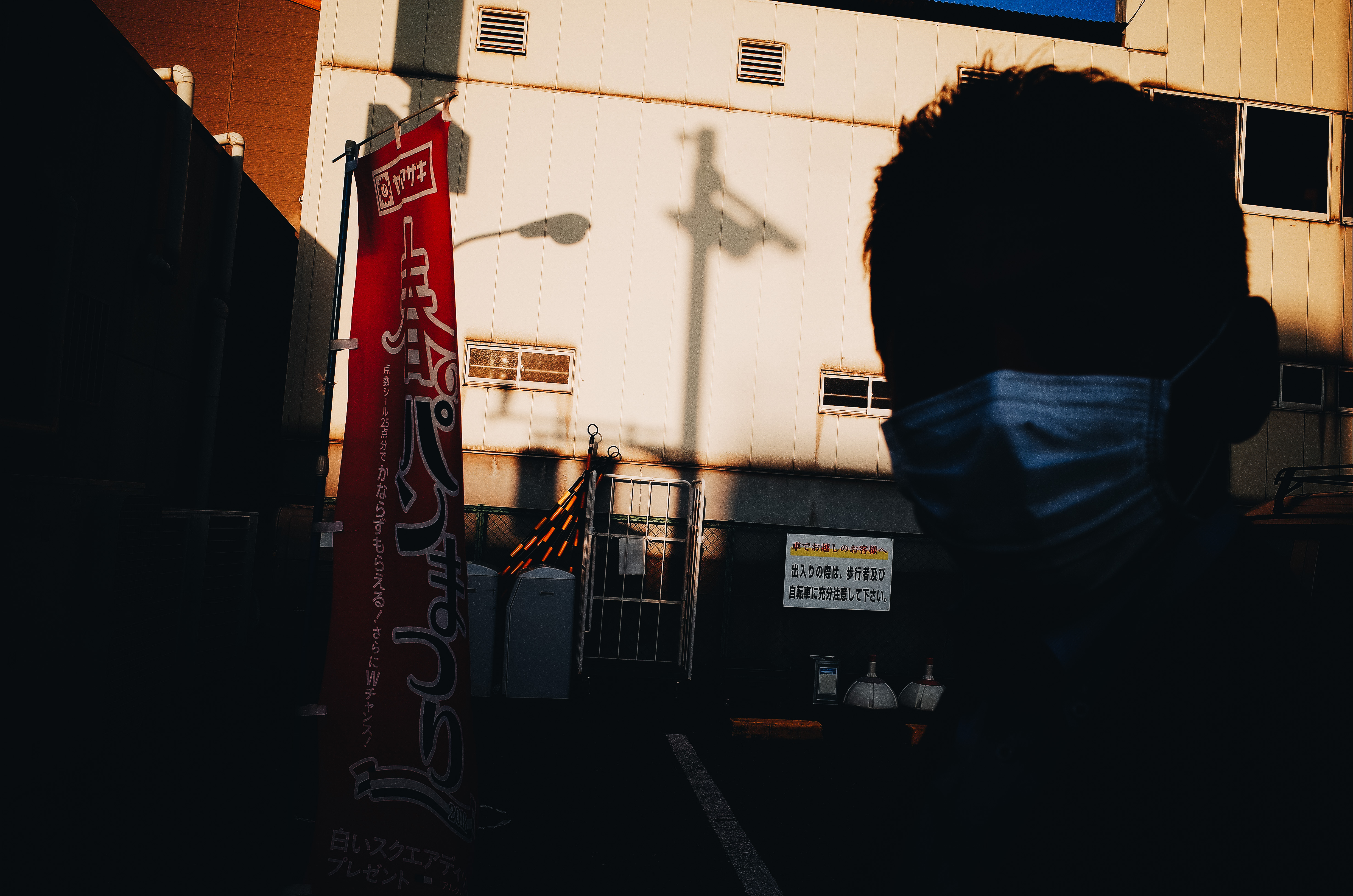 man with mask ricoh sunset light