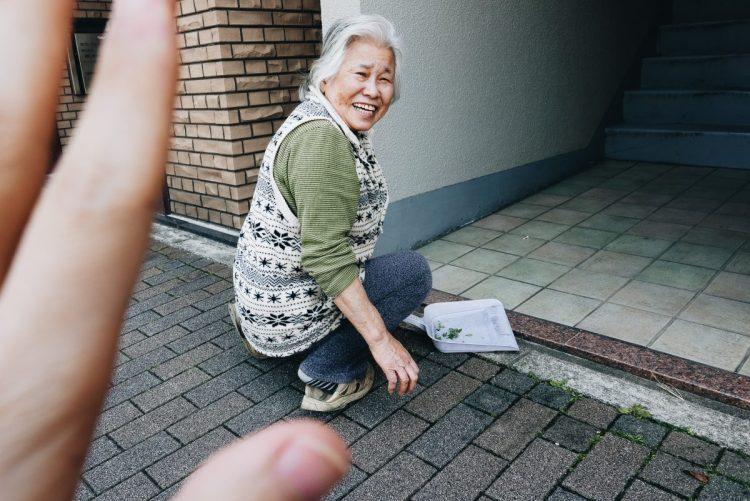 Hand framing hello woman Kyoto old woman