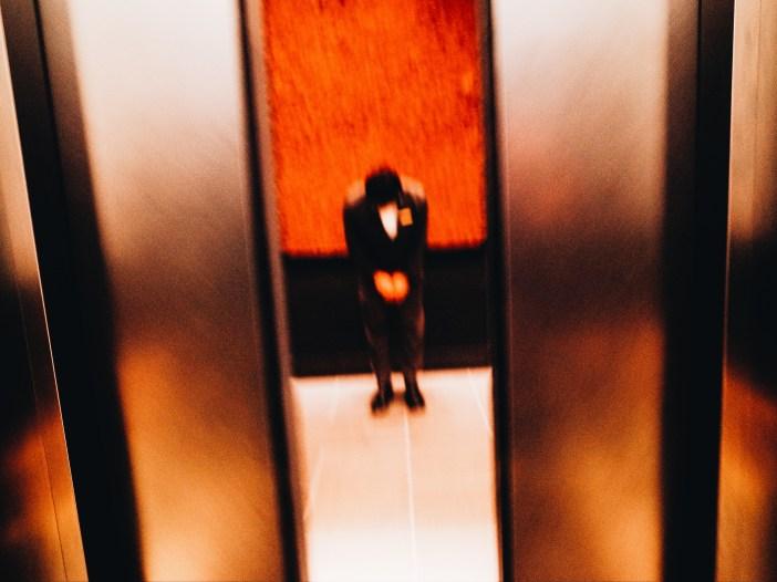 Man bowing at Aman Hotel. Tokyo, 2018