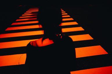 Cindy at night in Tokyo wirh red and orange light at crosswalk. Ricoh GR II x ERIC KIM PRESET