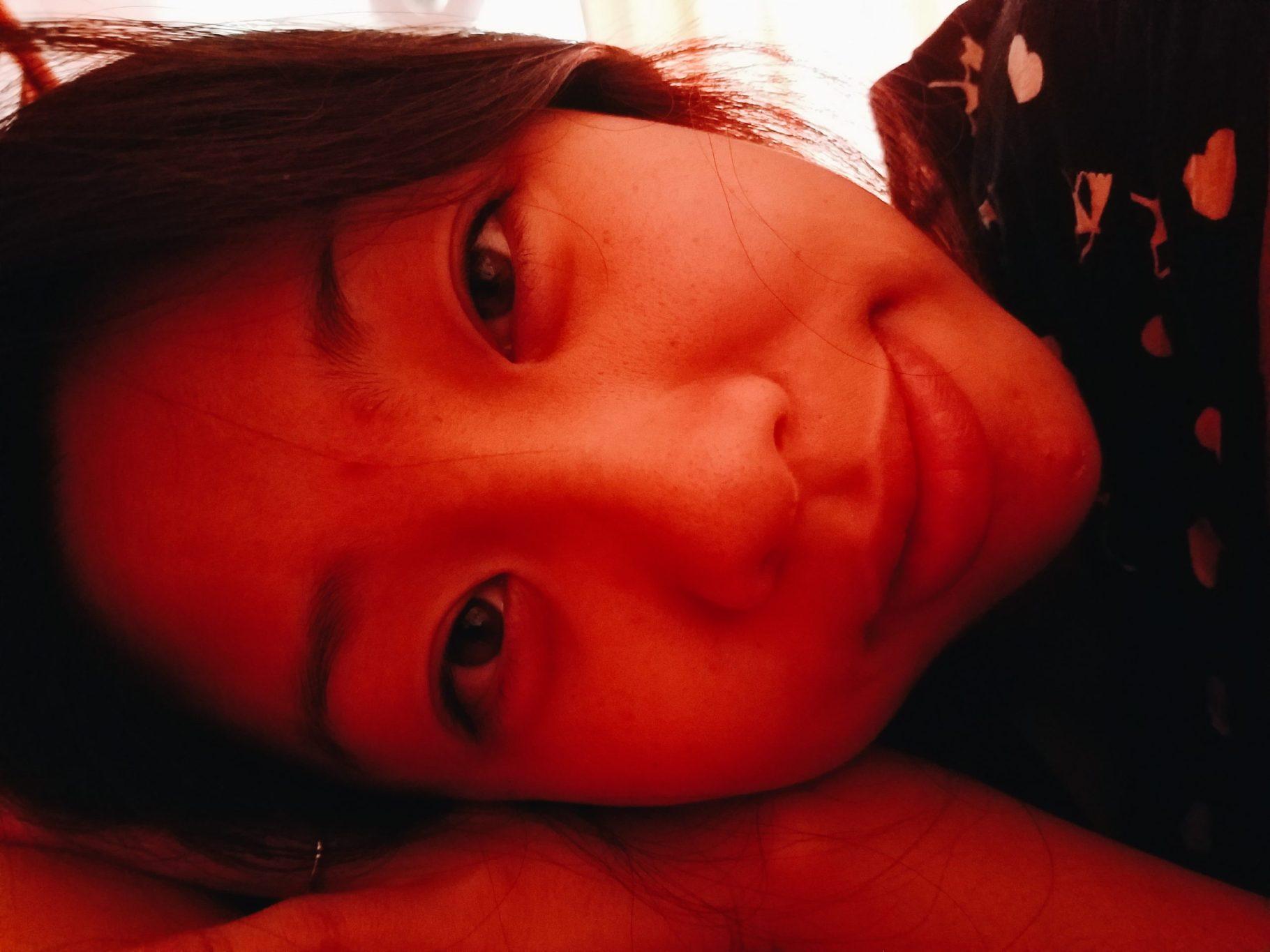 Cindy lying side me in bed; phone; berlin