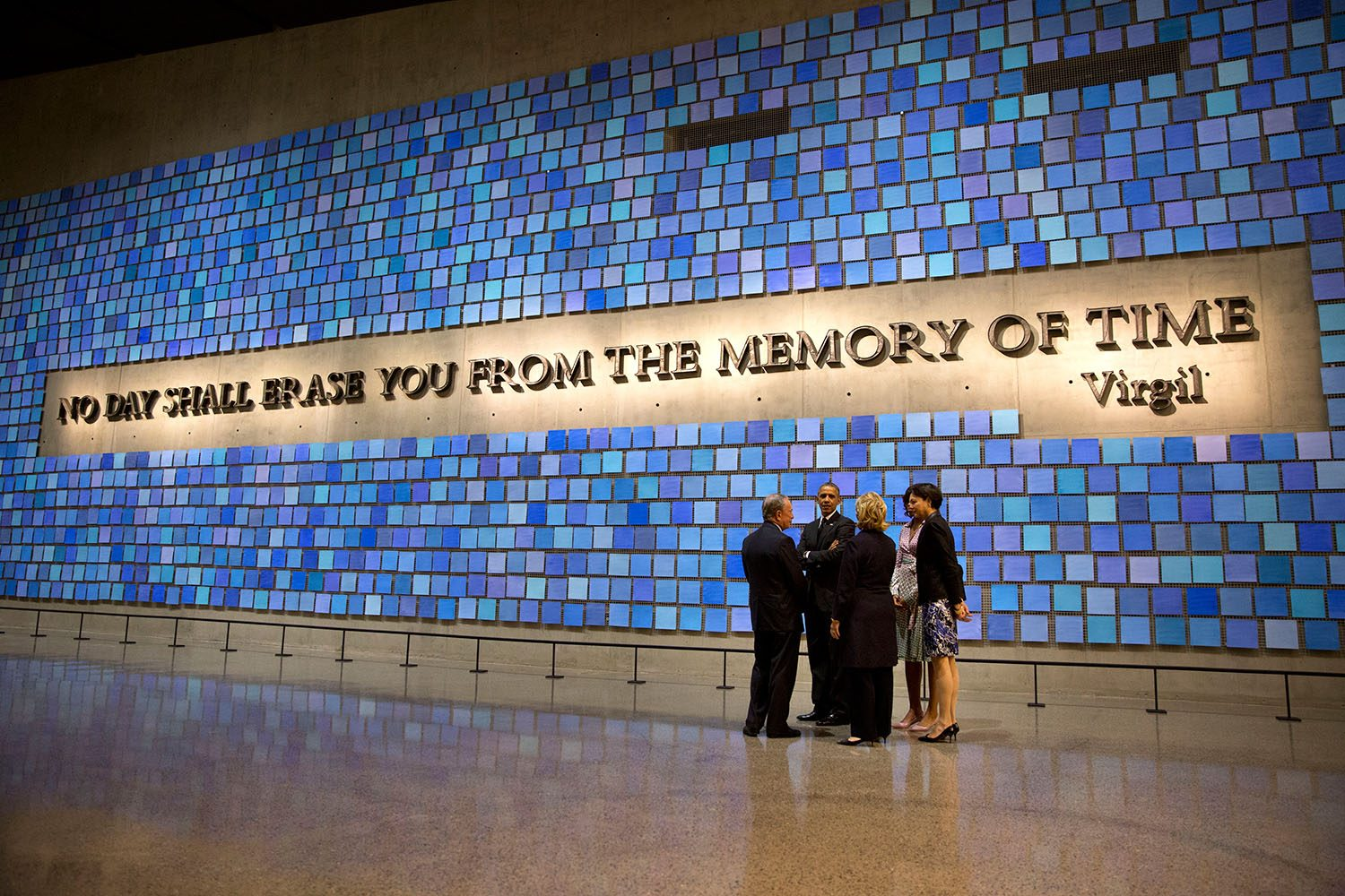 President Barack Obama and First Lady Michelle Obama talk with former New York City Mayor Michael Bloomberg, his partner Diana Taylor, and former Secretary of State Hillary Rodham Clinton as they stand near the Virgil Wall during a tour of the National September 11 Memorial & Museum, in New York, N.Y., May 15, 2014. (Official White House Photo by Pete Souza)