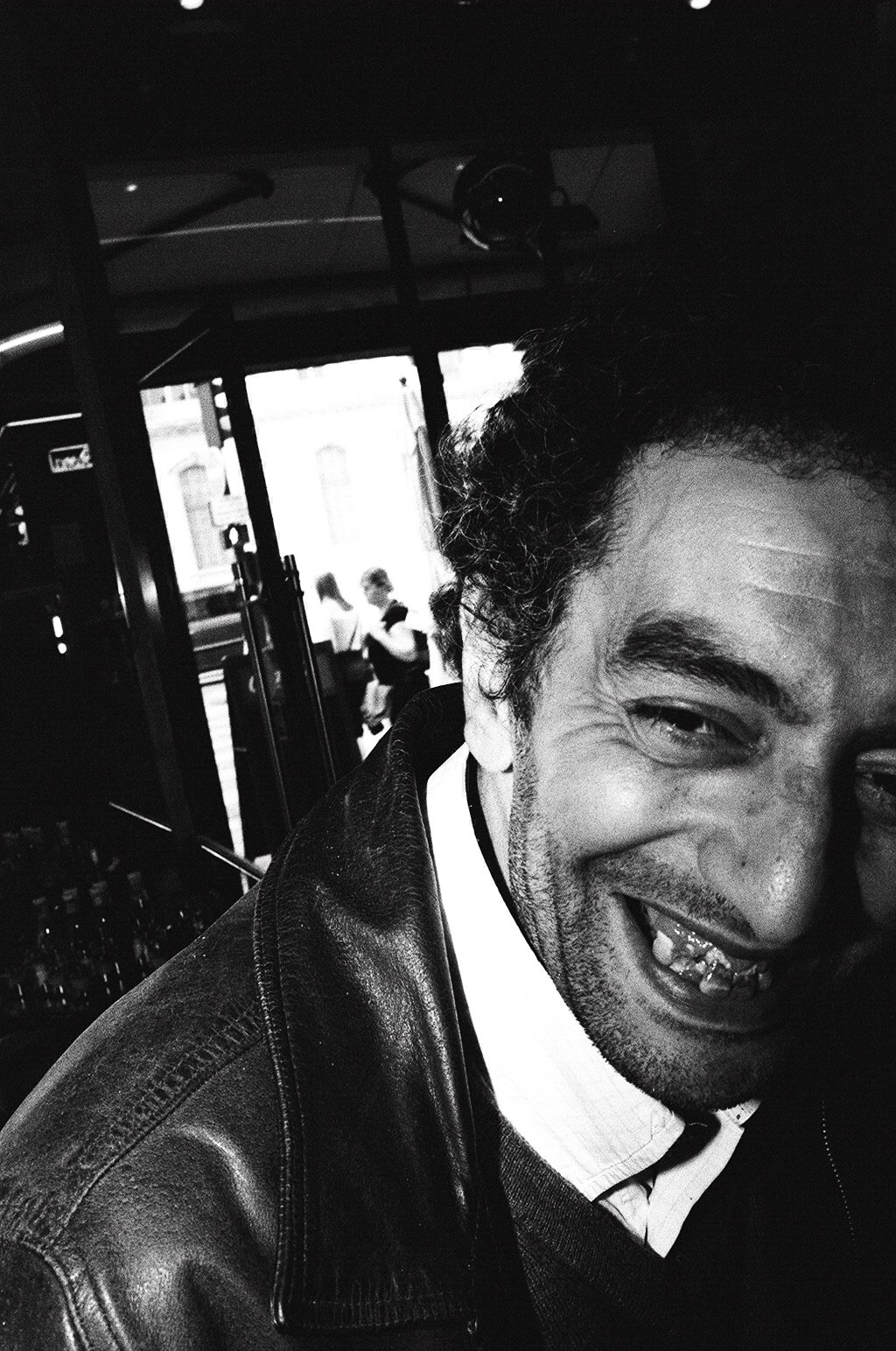Flash photo I shot while chatting up a gentleman in Paris, catching his laughing gesture.