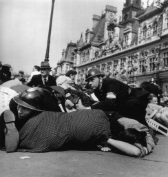 FRANCE. Paris. August 26th, 1944. Crowd on the pavement after snipers in buildings overlooking the Place de l'Hotel de Ville opened fire on the celebrations after the liberation.