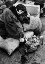 SPAIN. Barcelona. January 1939. Little girl resting during the evacuation of the city.