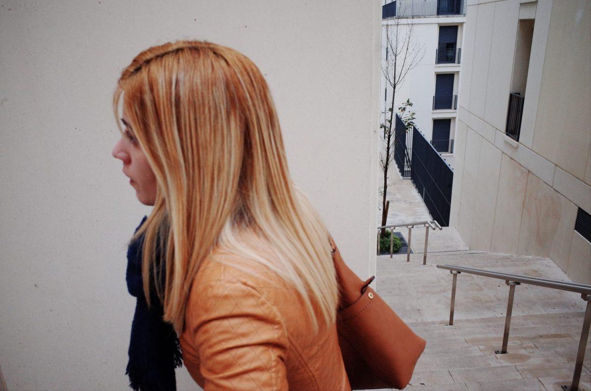Lisbon walking woman