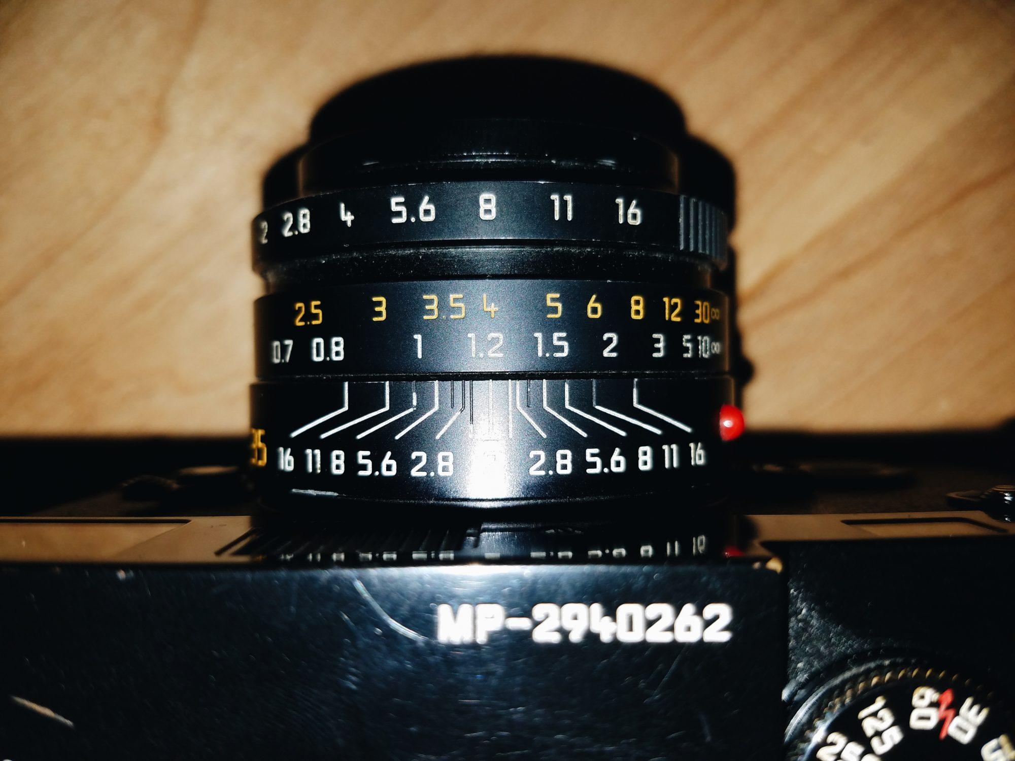 Good default distance is f/8, pre-focused at 1.2 meters